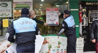 Marketlere ve dükkanlara uyarı afişleri dağıtıldı
